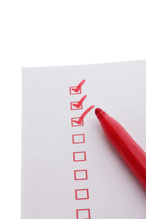 Checklist and red marker isolated on white photo