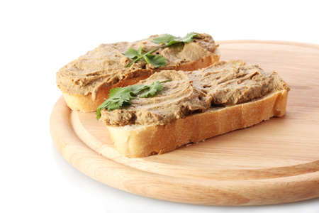 Fresh pate on bread on wooden board photo