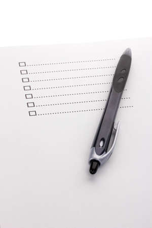 Checklist and pen closeup photo
