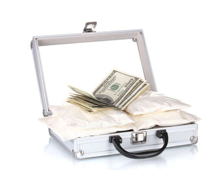 amphetamine: cocaine with money in a suitcase isolated on white