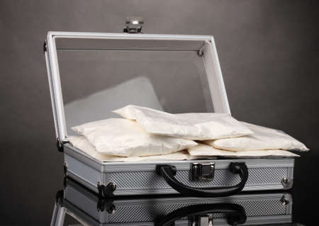 amphetamine: Ð¡ocaine in a suitcase on grey background