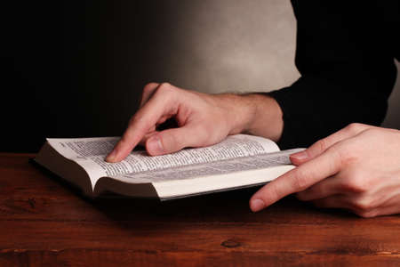 Reading open russian holy bible on wooden table photo
