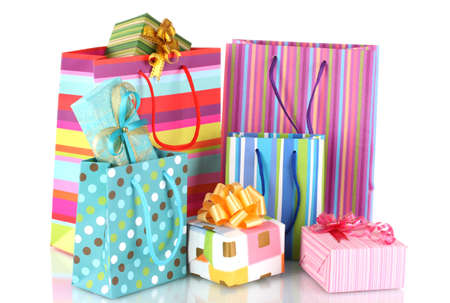 gift bags: bright gift bags and gifts isolated on white