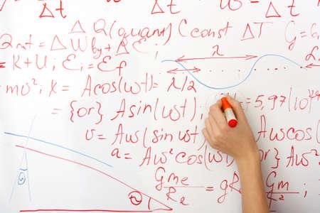 writing on the whiteboard formulas, closeup photo