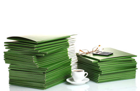 Many green folder with cup of coffee isolated on white photo
