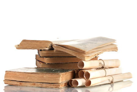 Pile of old books and scroll isolated on white photo