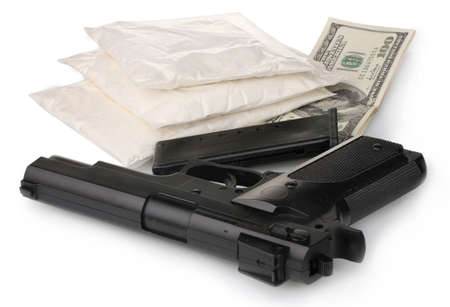 illegal substance: Ð¡ocaine in packet with gun and money isolated on white Stock Photo