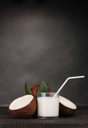 Coconut milk and coconut on grey photo