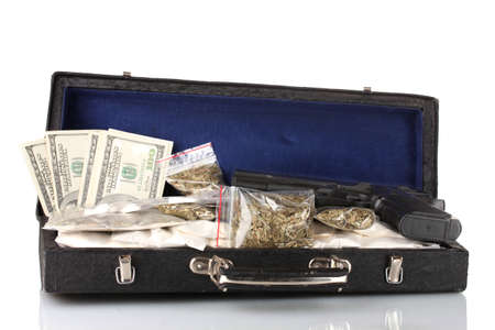 illegal drugs: Cocaine and marijuana with gun in a suitcase isolated on white Stock Photo