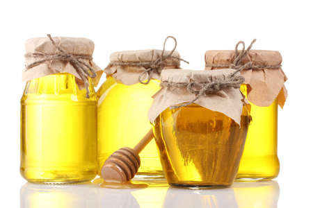 golden honey: Honey isolated on white