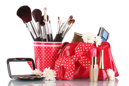 tool bag: red glass with brushes and makeup bag with cosmetics isolated on white Stock Photo