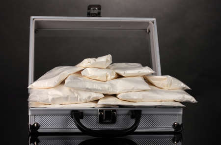 amphetamine: Cocaine in a suitcase on grey background