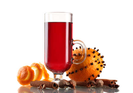 mulled wine in the glass, spice and orange isolated on white photo