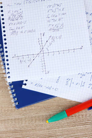 Math, physics and geometry on copybook page on a wooden table Stock Photo - 11905477