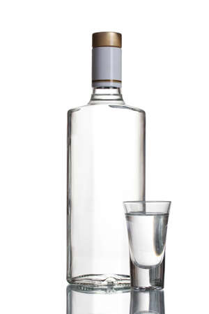 Bottle of vodka and wineglass isolated on white Stock Photo - 11905358