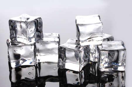 Ice cubes on grey background photo