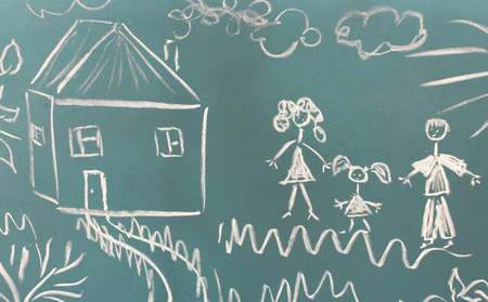 Blackboard with drawing happy family with house closeup photo