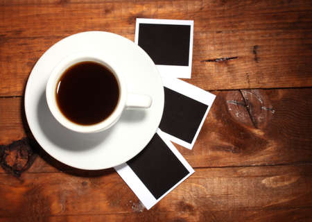 Photo paper with coffee on wooden background photo