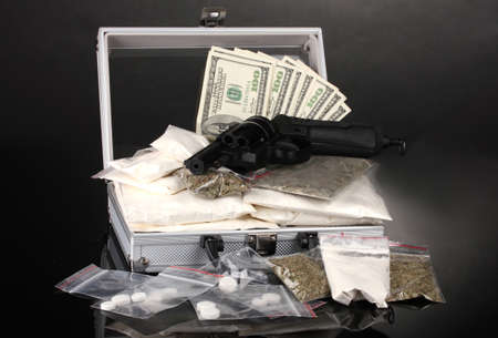 meth: Cocaine and marijuana with gun in a suitcase on grey background Stock Photo