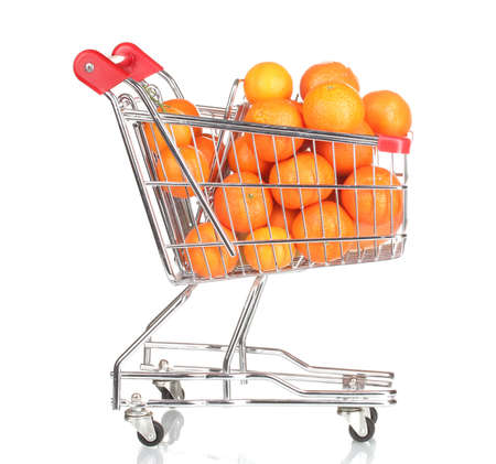 Ripe tasty tangerines in shopping cart isolated on white photo