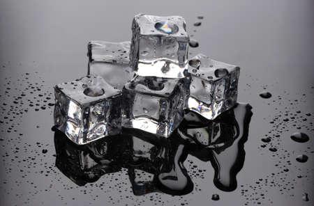 Melting ice cubes on grey background photo