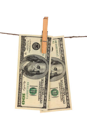 Two one hundred dollar bills is hanging on a rope with wooden clothespin isolated on white photo