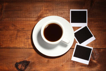Photo papers with coffee on wooden background photo