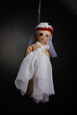 hanged woman: Hanged doll voodoo girl-bride  on grey background