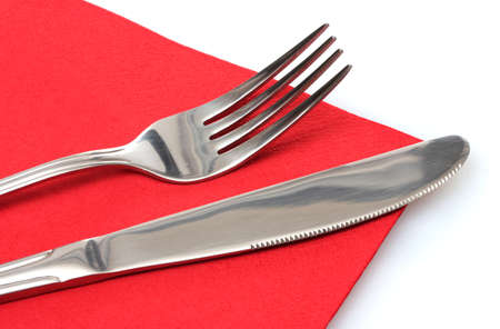 Fork and knife in a red cloth  isolated on white Stock Photo - 11954026