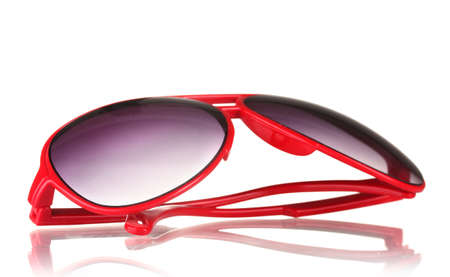 Womens red sunglasses isolated on white photo