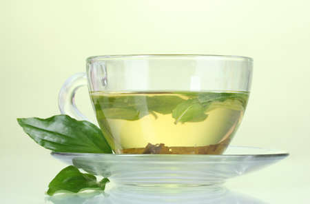 cups of tea: green tea in transparent cup with lime Stock Photo