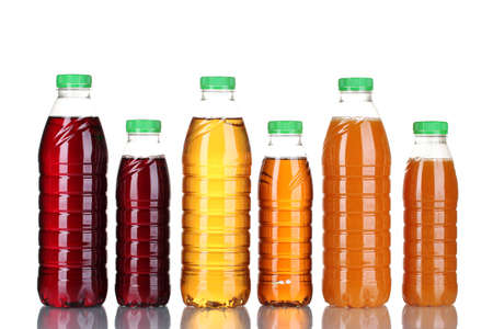 Bottles with juice isolated on white photo