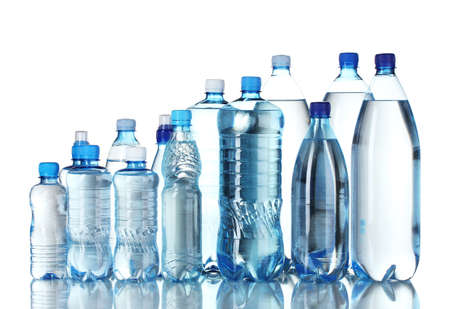 Group plastic bottles of water isolated on white Stock Photo