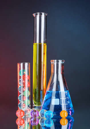 Test-tubes on blue-red background photo