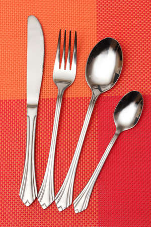 Fork, spoon and knife in a red cloth Stock Photo - 11999394