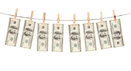 Alot of one hundred dollar bills is hanging on a rope with wooden clothespin isolated on white photo