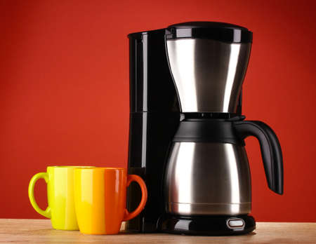 Coffee maker on red background photo
