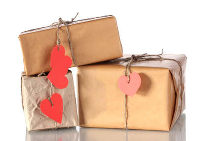 Three parcels with blank heart-shaped labels isolated on white Stock Photo - 12015815
