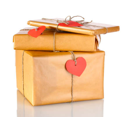 Three parcels with blank heart-shaped labels isolated on white photo