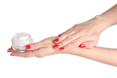 Female hands with manicure holding cream isolated on white photo