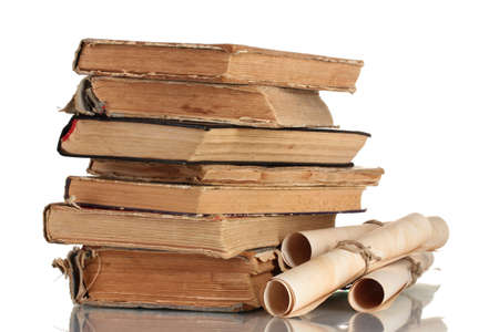 the arts is ancient: Pile of old books and scroll isolated on white