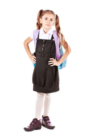Portrait of beautiful little girl in school uniform with backpack. Isolated on white Stock Photo - 12329823
