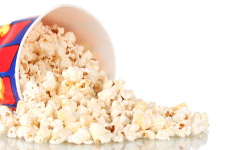Full bucket of popcorn dropped isolated on white photo
