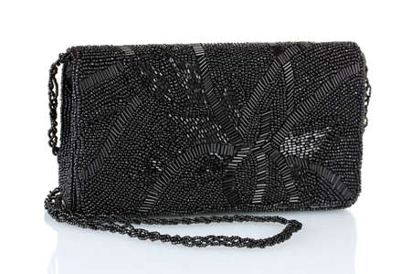 Black clutch embroidered with beads isolated on white photo