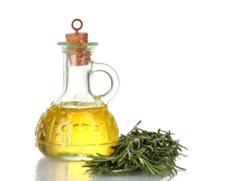 rosmarin: Oil in a bottle and fresh rosemary isolated on white