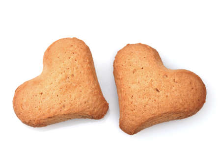 Two heart-shaped cookies isolated on white Stock Photo - 12100938