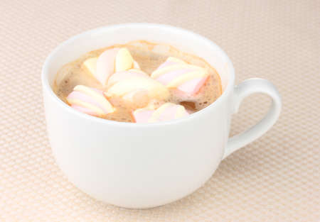Cup of cappucino with marshmallows on beige background Stock Photo - 12100946