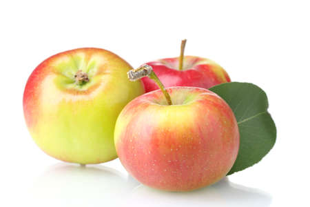 Ripe tasty apples isolated on white photo