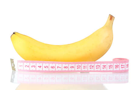 dominance: Ripe banana and measuring tape isolated on white Stock Photo