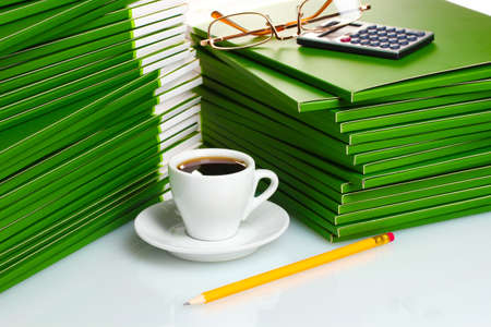 Many green folder with cup of coffee closeup photo